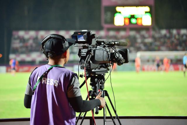 Cameraman recording sports match